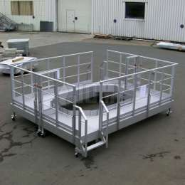 Mobile interlocking industrial platforms on wheels for machine assembly and maintenance.